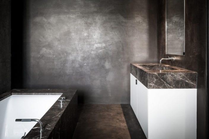 Dark brown beton ciré wallcovering