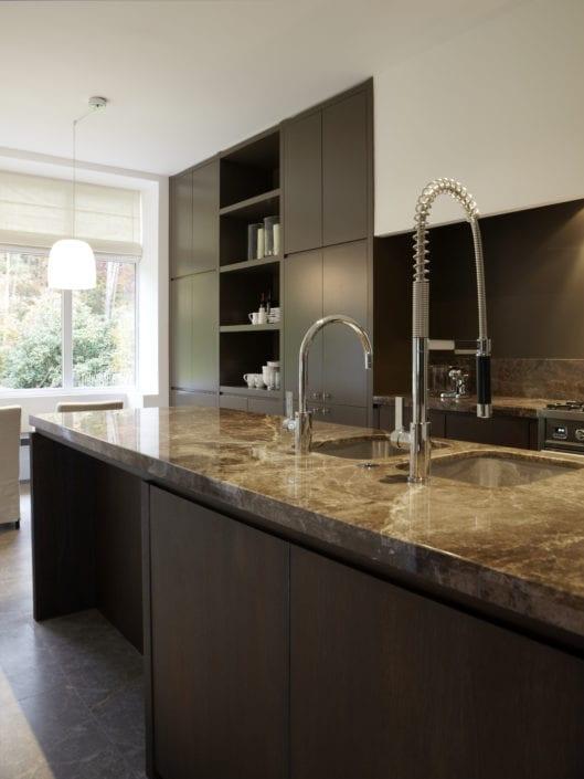 Polished dark brown emperador marble counter